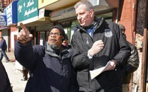Mayor de Blasio walking with an advocate on the street
