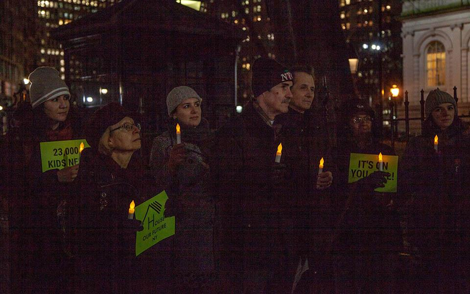 Members of the House Our Future NY Campaign hold a candlelight vigil.