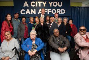 Large group of people posing with Mayor de Blasio