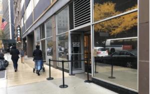 People walking down NYC sidewalk